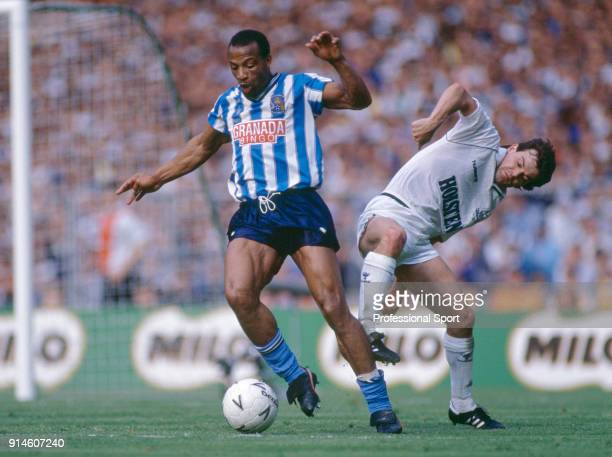 Coventry City striker Cyrille Regis shields the ball from Steve Hodge of Tottenham Hotspur during the FA Cup Final at Wembley Stadium on May 16 1987...