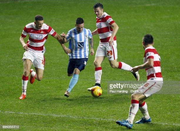 Coventry City's Adam Armstrong and Doncaster Rovers' Aaron TaylorSinclair and Harry Middleton