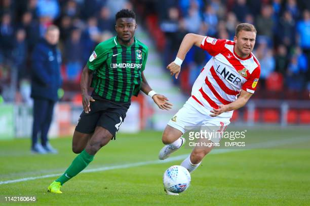 Coventry City's Bright Enobakhare and Doncaster Rovers' Herbie Kane battle for the ball Doncaster Rovers v Coventry City Sky Bet League One Keepmoat...