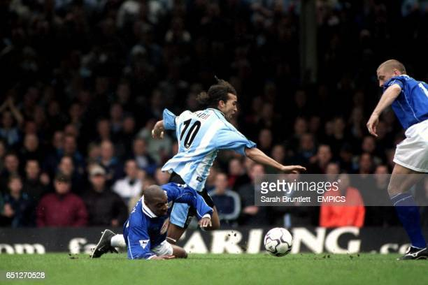 Coventry City's captain Mustapha Hadji is brought down by a challenge from Leicester City's Andrew Impey