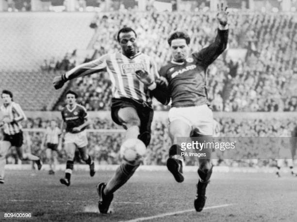 Coventry City's Cyrille Regis and Manchester United's John Sivebaek battle for the ball