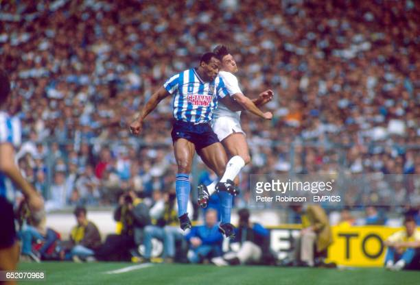 Coventry City's Cyrille Regis contests a header with Tottenham Hotspur's Gary Mabbutt