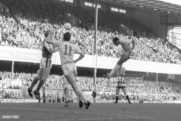 Coventry City's Cyrille Regis heads the ball towards the Arsenal goal Trying to block it is Arsenal's Lee Dixon