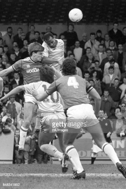 Coventry City's Cyrille Regis wins the header from Charlton Athletic's Colin Pates teammate Gary Bannister and Charlton Athletic's Peter Shirtliff