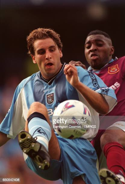 Coventry City's Darren Huckerby gets ahead of West Ham United's Andrew Impey