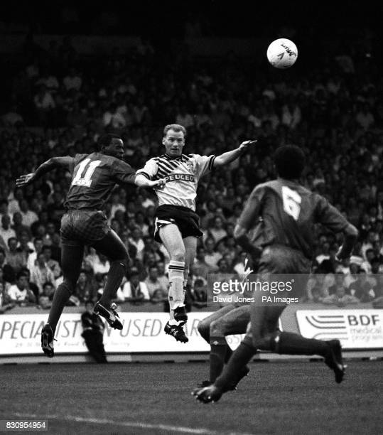 Coventry City's David Speedie and Crystal Palace's Alex Dyer jump for a high ball during today's first division match at Selhurst Park