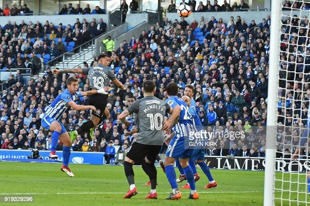 Coventry City's English striker Jonson ClarkeHarris misses with this header during the English FA Cup fifth round football match between Brighton and...
