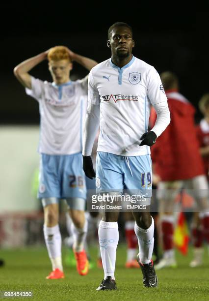 Coventry City's Frank Nouble leaves the field at the end of the game