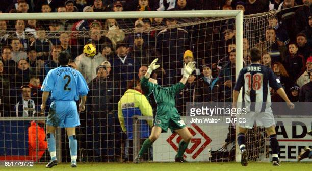 Coventry City's goalkeeper Andy Goram is unable to keep the ball out as West Bromwich Albion's Daniele Dichio scores the only goal of the game