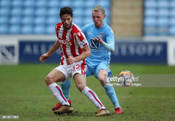 Coventry City's Jack Grimmer and Stoke City's Ramadan Sobhi battle for the ball during the FA Cup third round match at the Ricoh Arena Coventry