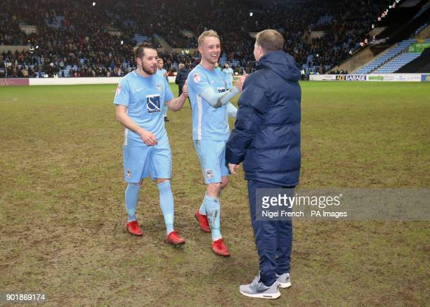 Coventry City's Jack Grimmer celebrates victory with manager Mark Robins after the FA Cup third round match at the Ricoh Arena Coventry