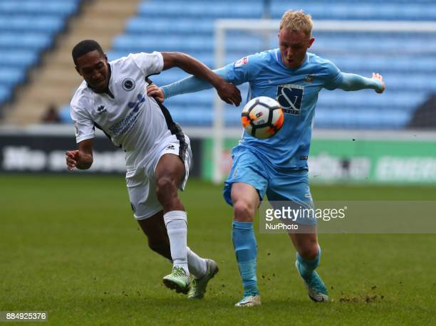 Coventry City's Jack Grimmer holds of Ricky Shakes of Boreham Wood during The Emirate FA Cup Second Round match between Coventry City against Boreham...