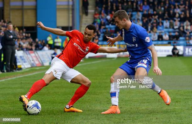 Coventry City's Jacob Murphy is challenged by Gillingham's Ben Dickenson