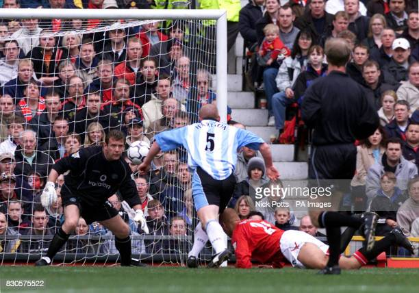 LEAGUE Coventry City's John Hartson stabs the ball past Manchester United goalkeeper Andy Goram to score the first goal during the FA Carling...