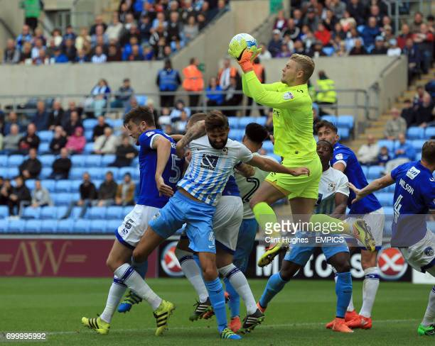 Coventry City's Jordan turnbull is beaton to the ball by Oldham Athletic's goal keeper Connor Ripley