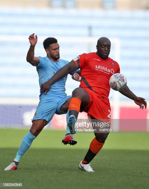Coventry City's Jordan Willis and Wycombe Wanderers' Adebayo Akinfenwa battle for the ball Coventry City v Wycombe Wanderers Sky Bet League One Ricoh...