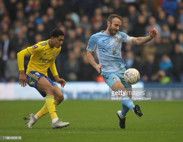 Coventry City's Liam Kelly battles with Birmingham City's Jude Bellingham during the FA Cup Fourth Round match between Coventry City and Birmingham...