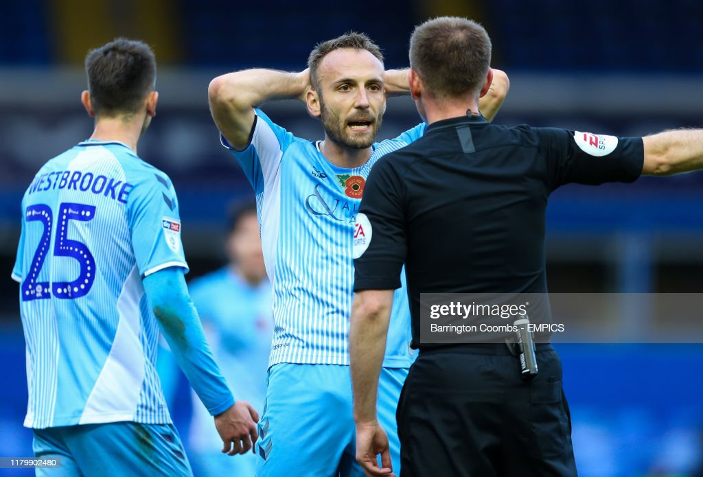Coventry City's Liam Kelly speaks with referee Ollie Yates during ...