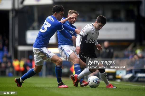 Coventry City's Liam Walsh battles with Ipswich Town's Andre Dozzell and Alan Judge during the Sky Bet League One match between Ipswich Town and...