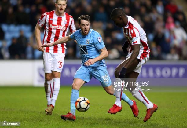 Coventry City's Marc McNulty and Stoke City's Kurt Zouma battle for the ball during the FA Cup third round match at the Ricoh Arena Coventry