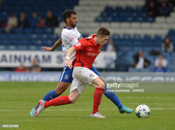 Coventry City's Ryan Kent is tackled by Bury FC's Jacob Mellis