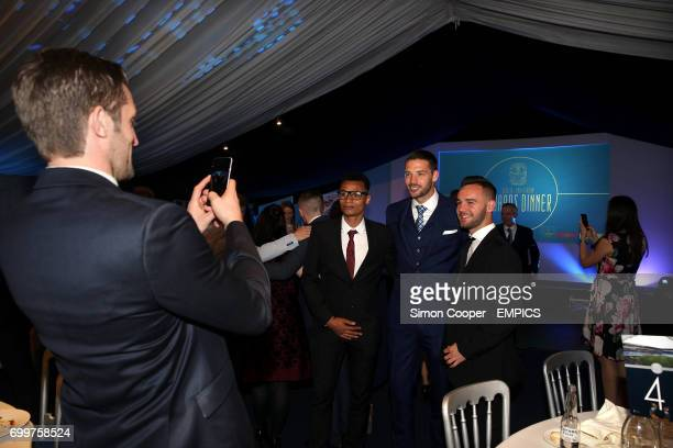 Coventry City's Sam Ricketts takes a photo of teammates Jacob Murphy Aaron Martin and Adam Armstrong during the end of season awards evening