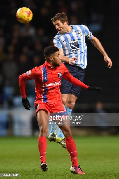 Coventry City's Sam Ricketts wins the ball in the air ahead of Gillingham's Dominic Samuel