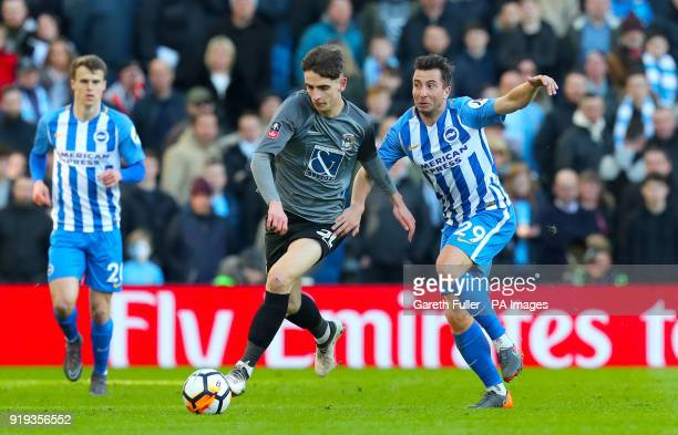 Coventry City's Tom Bayliss and Brighton Hove Albion's Markus Suttner battle for the ball during the Emirates FA Cup Fifth Round match at The AMEX...