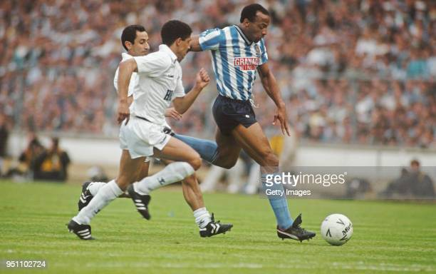 Coventry striker Cyrille Regis holds off the challenge of Spurs players Osvaldo Ardiles and Chris Hughton during the 1987 FA Cup Final between...