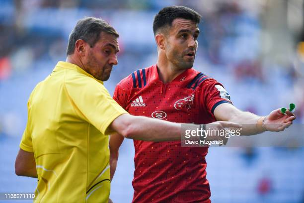 Coventry United Kingdom 20 April 2019 Conor Murray of Munster and referee Jérome Garcès during the Heineken Champions Cup SemiFinal match between...