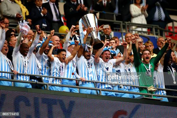 Coventry's Jordan Willis holds the cup aloft during the EFL Checkatrade Trophy Final between Coventry City and Oxford United at Wembley Stadium on...
