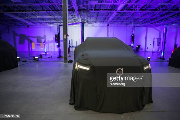 A cover conceals the Volvo S60 vehicle before an unveiling event at the official opening of the Volvo Cars USA plant in Ridgeville South Carolina US...