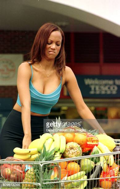 Cover girl model Tyra Banks with a trolley of fresh and healthy food in the car park at Tesco's supermarket in Hammersmith London where she launched...