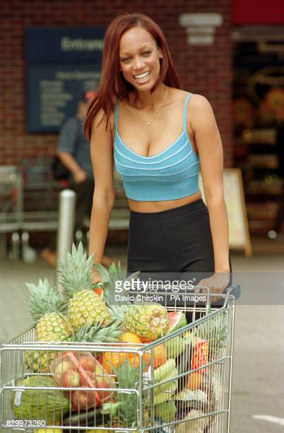 Cover girl model Tyra Banks with a trolley of fresh and healthy food at the Tesco supermarket in Hammersmith London where she launched IMG model...