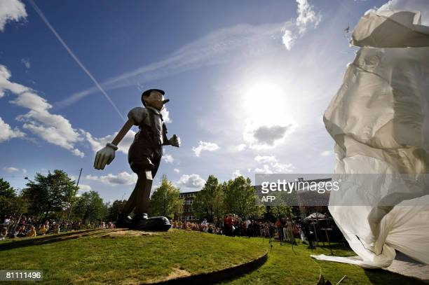A cover is taken away during the inauguration of the Pinocchio statue on May 16 2008 in a roundabout near central Boras western Sweden The nine...