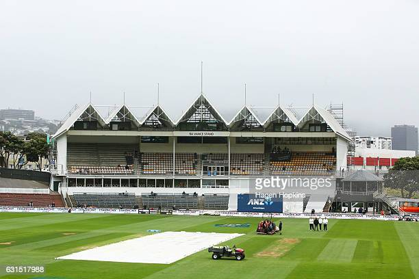 A cover lies on the wicket during a rain delay on day one of the First Test match between New Zealand and Bangladesh at Basin Reserve on January 12...