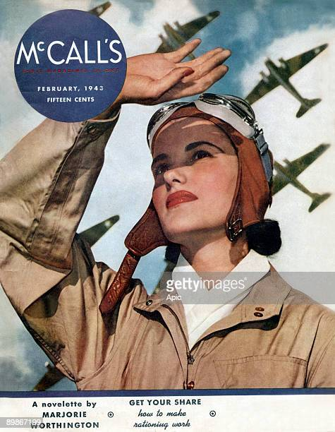 Cover of american magazine McCall's february 1943 a woman with a pilot suit is looking at the planes in the sky