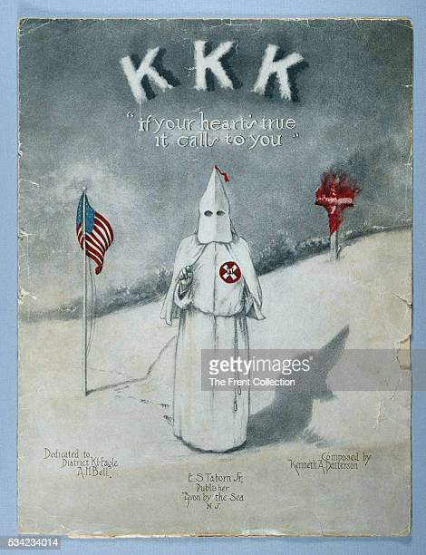 Cover of sheet music published in Avon By The Sea New Jersey in the 1920s shows a hooded Ku Klux Klansman flanked by an American flag and burning...