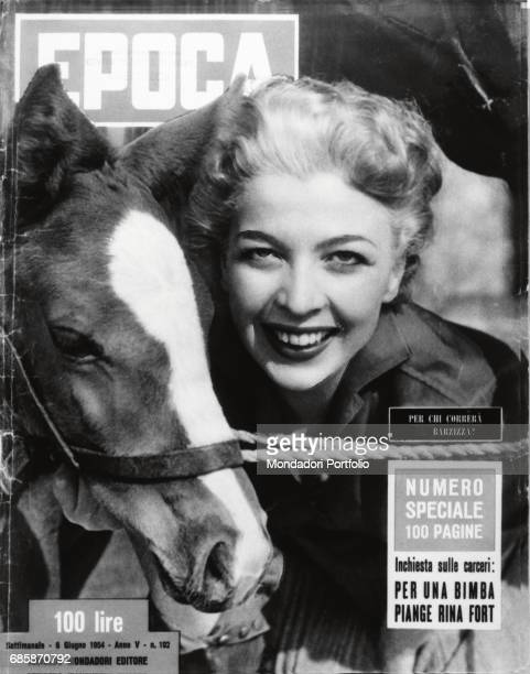 Cover of the magazine Epoca Actress Isa Barzizza smiling next to a horse 1954