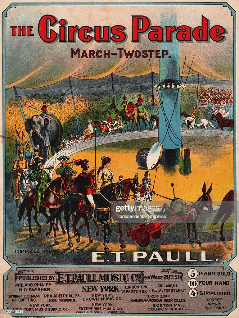 Cover of the sheet music for 'The Circus Parade' march and two-step by E.T. Paull features an illustration of the titular parade under a big top circus tent, published by the E.T. Paull Music Co., 1904.