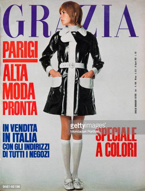 Cover of the women's magazine Grazia A model wearing a dress by Ungaro Parallele very light black oilskin with white neck cuffs facing and belt...