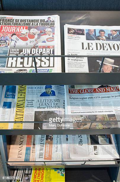 Cover page of a few Canadian newspapers in a stand