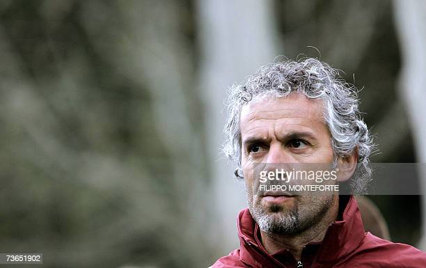Italy coach Roberto Donadoni looks on prior the afternoon training session at the National Technical Center of Coverciano in Florence 21 March...