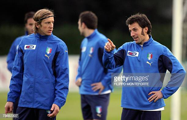 Italy's Alex Del Piero chats with Massimo Ambrosini during the afternoon training session at the National Technical Center of Coverciano in Florence...