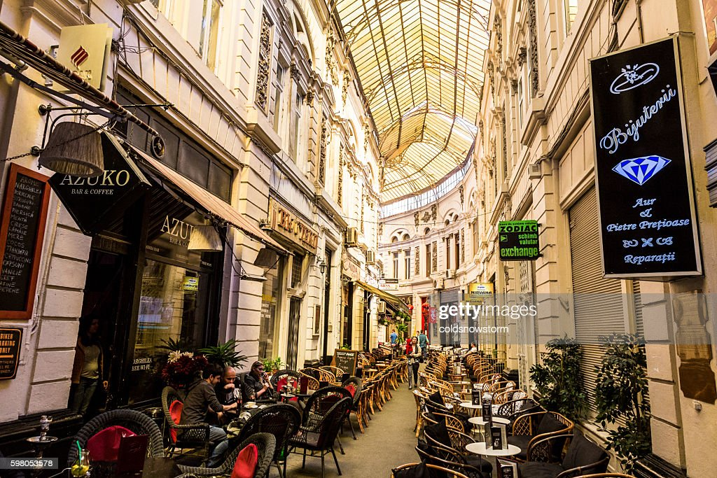 Covered arcade with bars and restaurants in Bucharest, Romania : Stock Photo