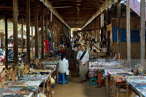 Covered area of the Indein local market with stalls of local handicrafts on sale for mostly tourists..