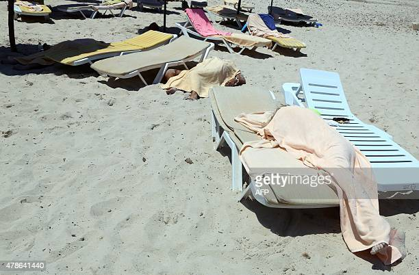 Covered bodies of victims of a massshooting are seen in the resort town of Sousse a popular tourist destination 140 kilometres south of the Tunisian...