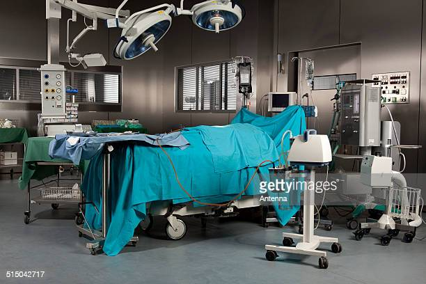 A covered body on a surgical operating table