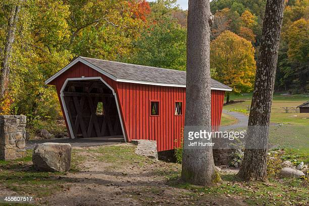 covered bridge and autumn tree colors - covered bridge stock pictures, royalty-free photos & images