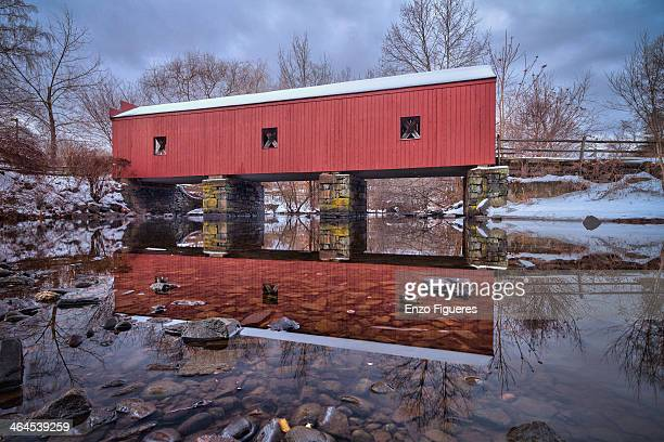 covered bridge during the winter - covered bridge stock photos and pictures